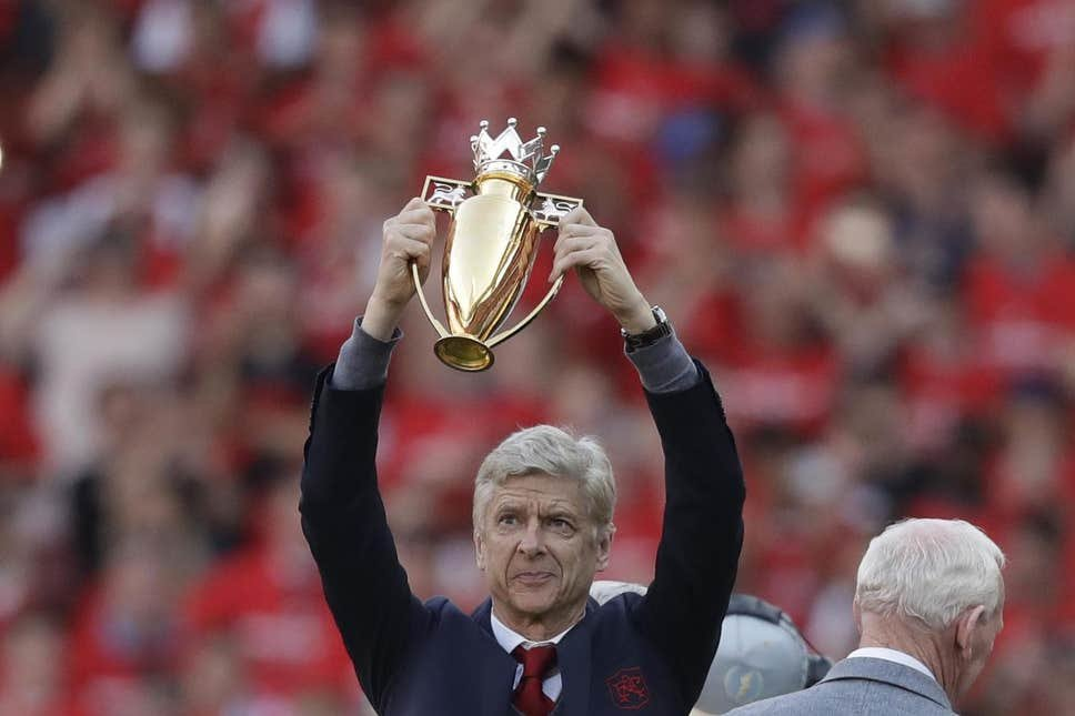 190940550-arsenal27s-french-manager-arsene-wenger-holds-a-trophy-he-was-presented-with-after-the-matc.jpg