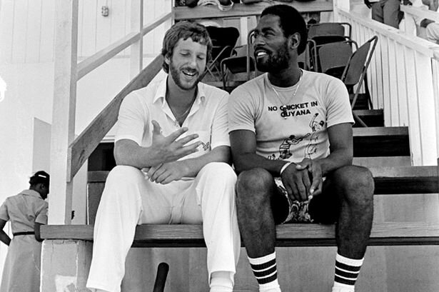 Ian Botham (left) of England talks to Viv Richards of the West Indies in Antigua during the England Cricket Tour to the West Indies in March 1981.jpeg
